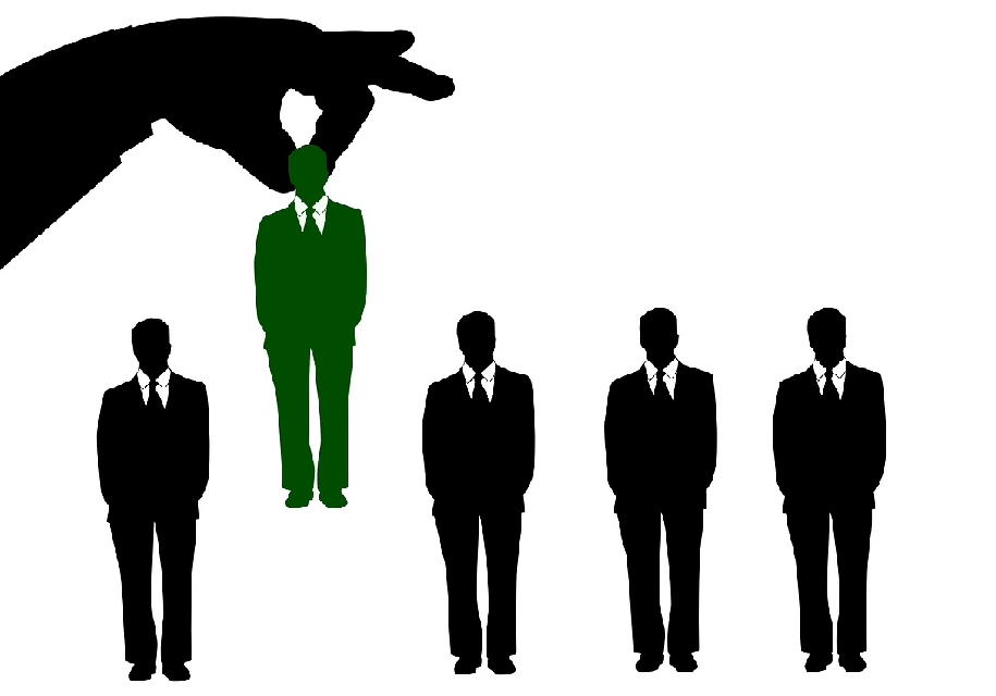 Image of a hand grabbing the silhouette of an employee candidate to represent hiring a WordPress developer